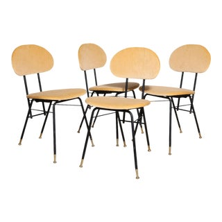 Set of Four Troy Sunshade Co. Yellow Upholstered Black Enamel Springback Chairs For Sale
