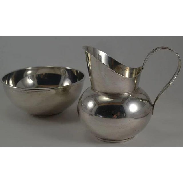 This is a lovely MCM Gorham sterling silver sugar and creamer set with pattern numbers 772 & 773. They are in very good...