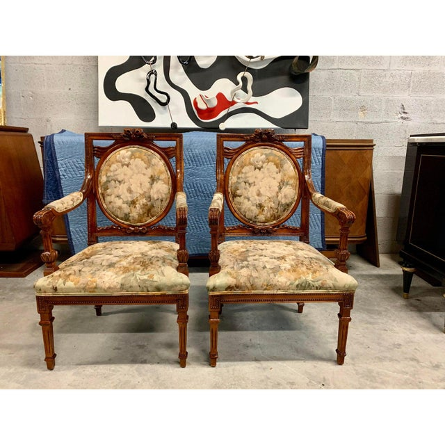 Pair of French Louis XVI Accent Chairs or Bergère Chairs, made of solid mahogany the mahogany wood has been finished with...