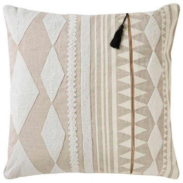 Beige patterned pillow cover by designer Nikki Chu for Jaipur Living. Solid backing differs from front design. Back cover...