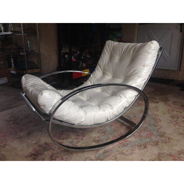 This is an authentic early 1970's Selig piece. Ellipsed chrome rocker is in excellent vintage shape with minor scratches...