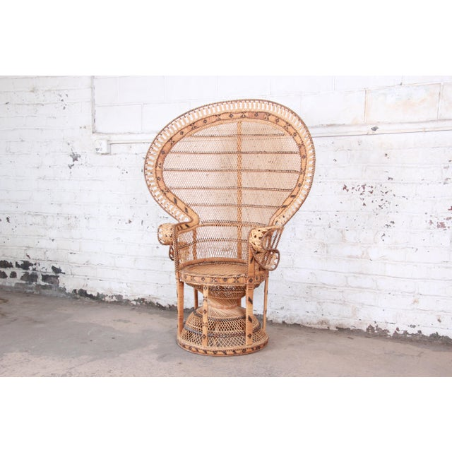 "A gorgeous and iconic mid-century modern ""Emanuelle"" wicker peacock chair. The chair features stunning woven wicker and..."