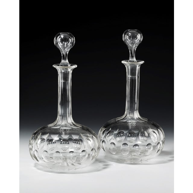 "A pair of Victorian period glass star and globe decanters. Retaining their original stoppers. 11"" high, circa 1860 $585"