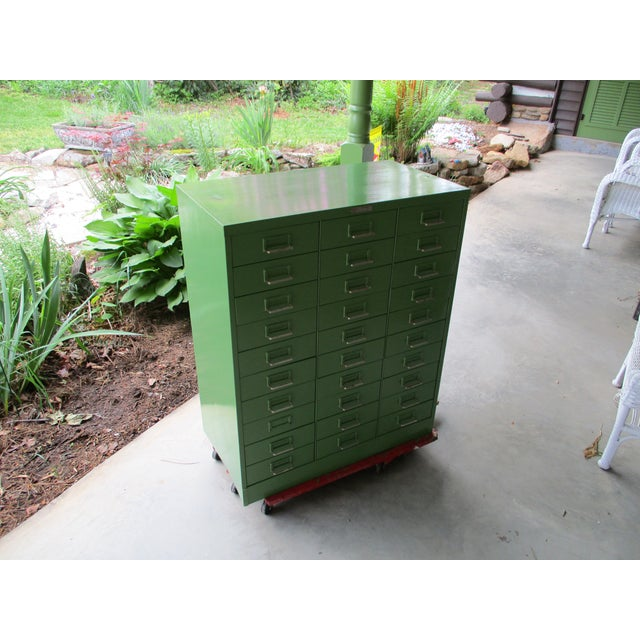Vintage industrial storage cabinet by Steelmaster Art steel Company, New York. The metal cabinet has 30 drawers and...