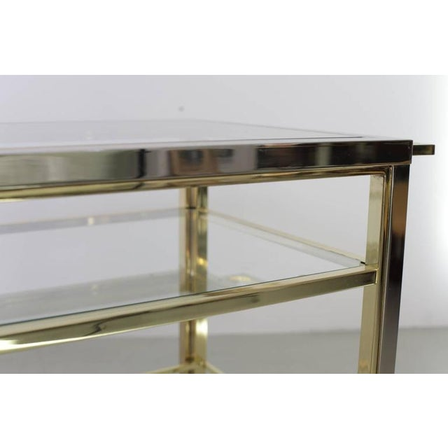 Rare, classical bar cart in chrome and brass manufactured in high end quality. The bar cart is made in the manner of Willy...