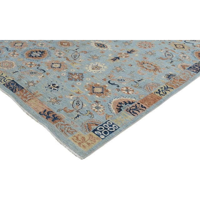 Skillfully hand knotted by master weavers, this alluring rug made with hand spun, vegetable dyed wool and a muted color...