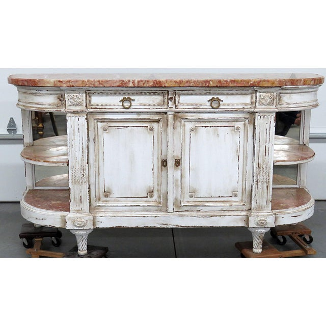 Antique marble top distressed painted sideboard with 2 mirrored back marble top shelves on each side, 2 doors, and 2 drawers.