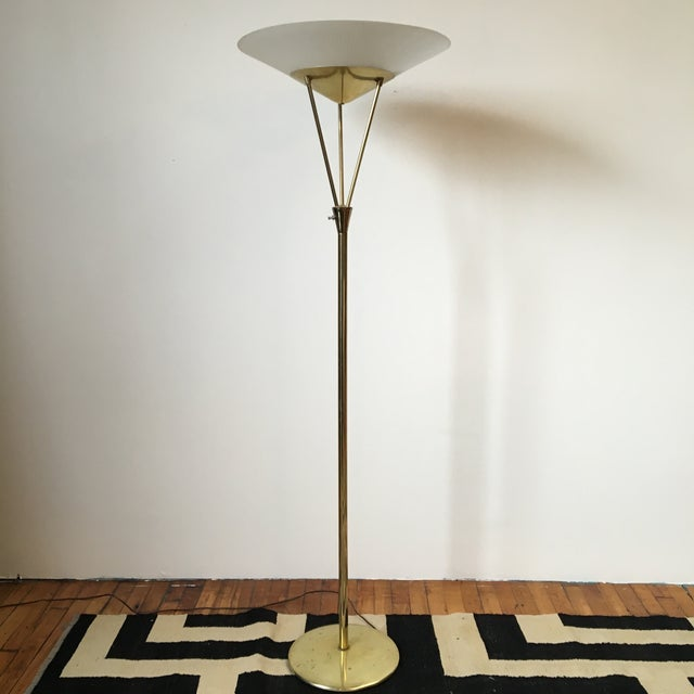 A masculine meets feminine floor lamp by Lightolier. Featuring a clean, modernist shape, this floor lamp reflects the...