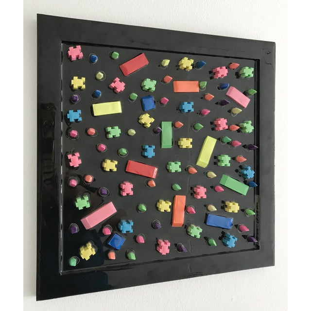 Rubber city 1 by Mauro Oliveira, signed. Erasers, acrylic paint covered with resin on wood frame. A certificate of...