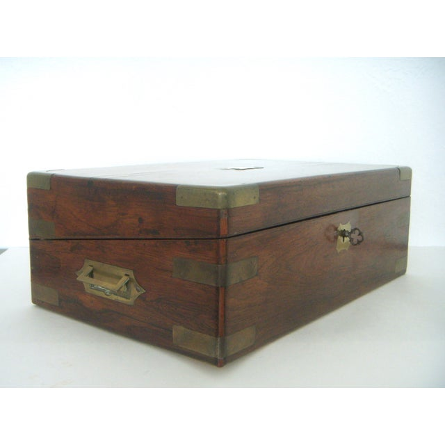 Antique English Walnut writing box or deed box embellished with protective brass corner and side fittings and lovely flush...