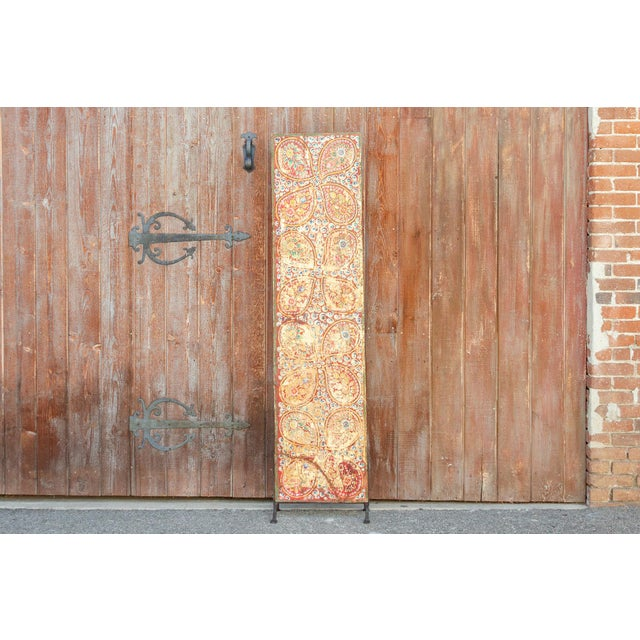 A 19th century Tibetan door from Kunchen in Tibet. This festive colorful door with intricate paisley patterns that create...