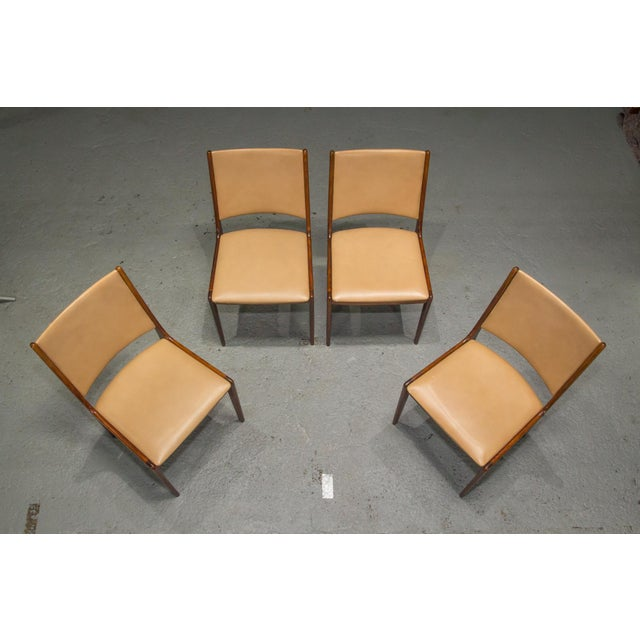 Set of 4 Danish Modern Rosewood and Leather Dining Chairs. This item includes restricted materials and can not be sold...