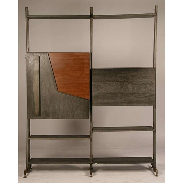 An unusual cerused mahogany mid-century modern modular etagere with a fall front bar section and adjustable shelves.