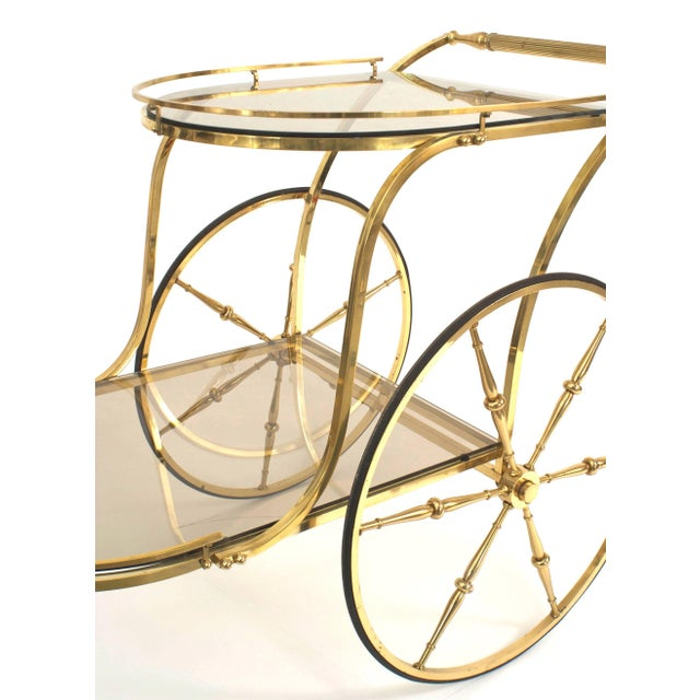 Italian Mid-Century (1950s) brass liquor/drinks trolley bar cart with one small front and two large back brass wheels and...