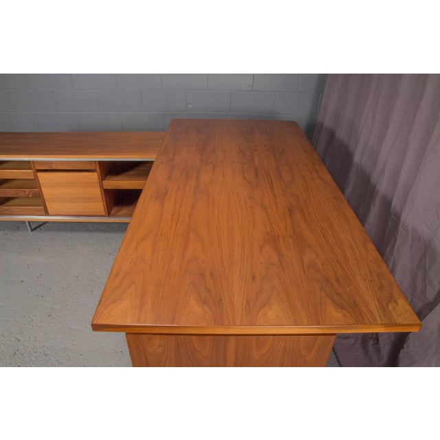 George Nelson for Herman Miller L-shaped executive desk unit. Rattan privacy panel.