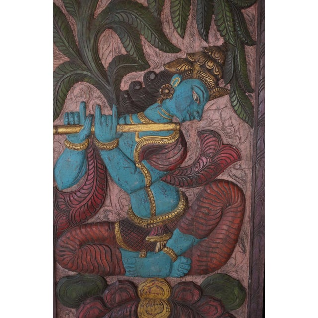 Indian carved door wood wall panels of Krishna Playing flute enjoying the beauty of Kadambari tree on the double lotus...