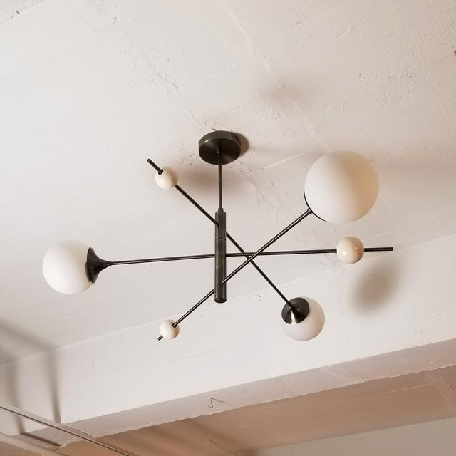 Handcrafted in NYC by Blueprint Lighting, our 'Orbital' 3-Arm Pendant is a more compact version of our wildly popular...