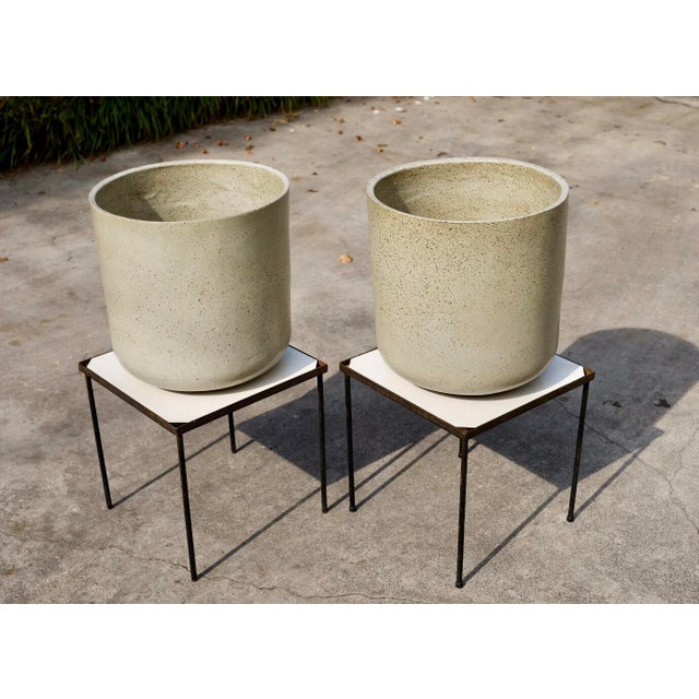 Exceedingly rare pair of hand thrown 1960s Malcolm Leland cylinders in a speckled oyster gray glaze. A stunning example of...