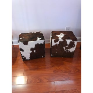Pair of Cow Hide Benches or Ottomans Preview