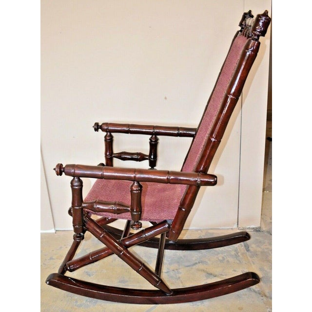 Early 20th Century Vintage Faux Bamboo Rocking Chair With Mahogany Finish and Maroon Upholstery For Sale - Image 5 of 10