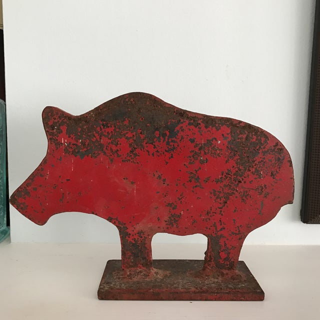 A super fun antique folk art shooting gallery target that looks to be in the shape of a pig or boar. It features its...