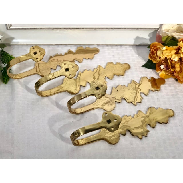 This is for 4 curtain tie backs that are a gold brass in the shape of leaves to hold your drapes away from the window.They...