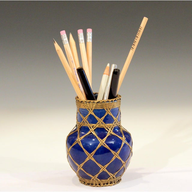Antique Awaji pottery brush pot or pencil jar in deep blue glaze with bronze wire over-weaving, circa 1910s. Measures: 4...
