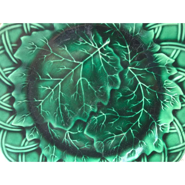 Late 19th -early 20th century green majolica cabbage plate with woven motif on border. Some light crazing/wear on surface...