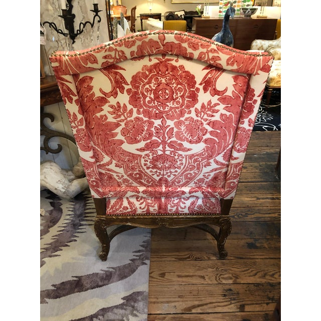 Very large vintage giltwood carved French style armchair, a bit chippy and lusciously weathered, upholstered in wonderful...