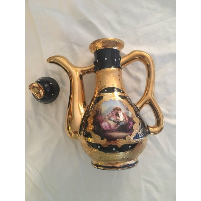 Persian serving set with gold leaf trim. New, never used. The set consists of a tray, a round plate, two pitchers with...