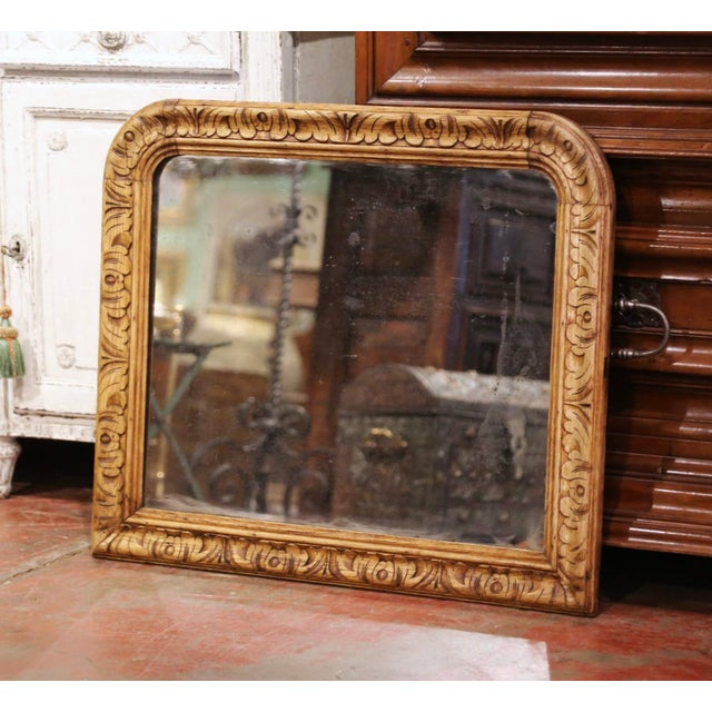 Crafted in France circa 1870, and built of oak wood, the antique mirror is rectangular in shape with rounded corners. The...