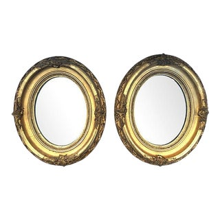 Oval Carved & Gilt Mirrors - a Pair For Sale