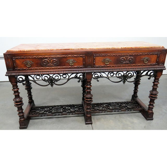 Regency style marble top 3 drawer sideboard with iron accents.