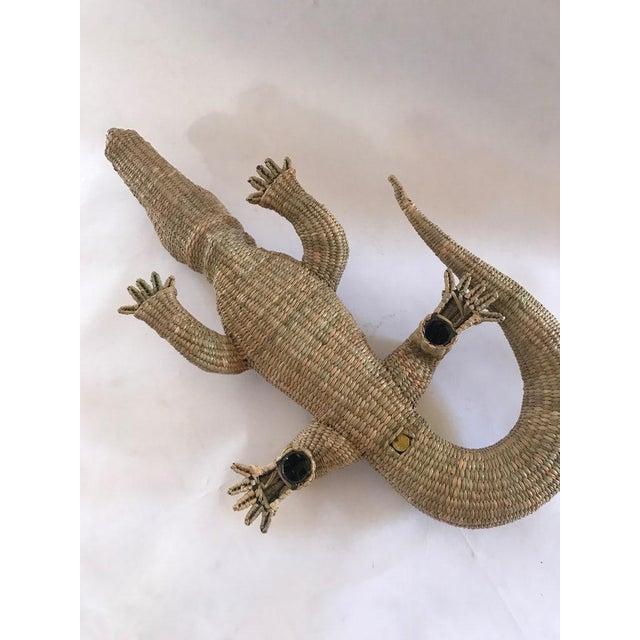 Mario Lopez Torres woven reed and copper crocodile. Hand made utilizing an iron form and wrapped with grasses from the...