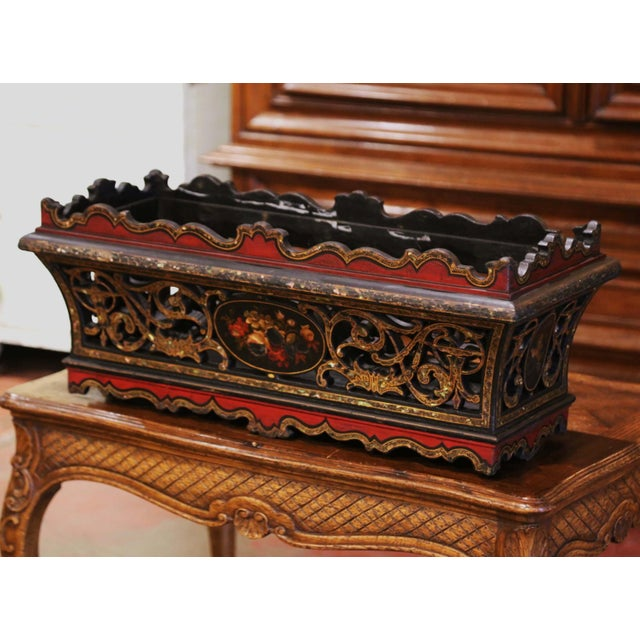 This colorful antique jardinière was created in France, circa 1880. Standing on a scalloped apron, the rectangular planter...