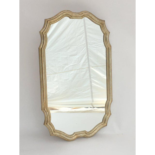 Simple, elegant, carved wood wall mirror with an antiqued silver leaf finish from well-known high-end mirror company,...