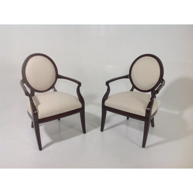 Pair of accent arm chairs. Chairs are done in a faux suede. Chairs have a rich mahogany finish. Chairs are in excellent...