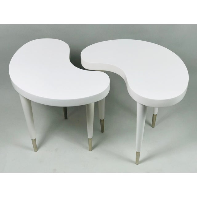 Stunning gloss white side tables. They are resin with stainless feet. Elegant, heavy, quality. Love this San Francisco...