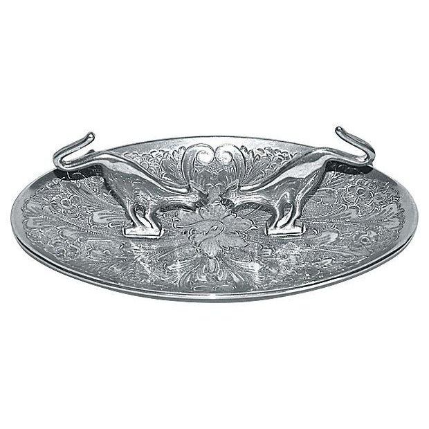 A charming oval ring or coin dish featuring two long-tailed cats. It is marked on the underside: Seba Silver plated, Made...