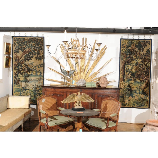 A pair of French 19th century handmade vertical tapestries with pastoral motifs. Born in France during the 19th century,...