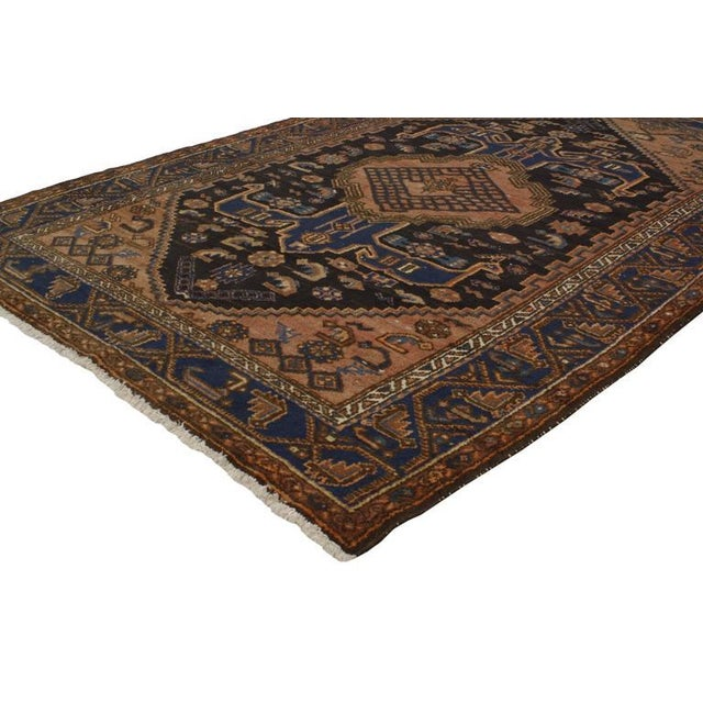 Full of character and stately presence, this antique Persian Hamadan rug with modern tribal style showcases an extravagant...