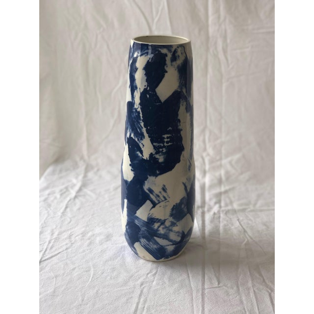 This tall vase is painted in a criss cross pattern with rich thick cobalt slip, which is allowed to dry, then wiped off....