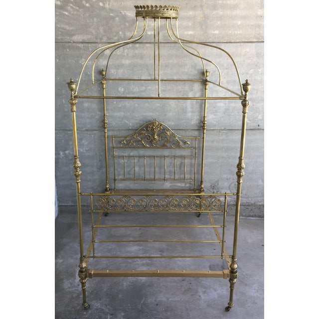 About 19th Wide Brass Four Poster Bed with Bird Castings, Ornamental Motifs and Crown A magnificent all brass four-poster...