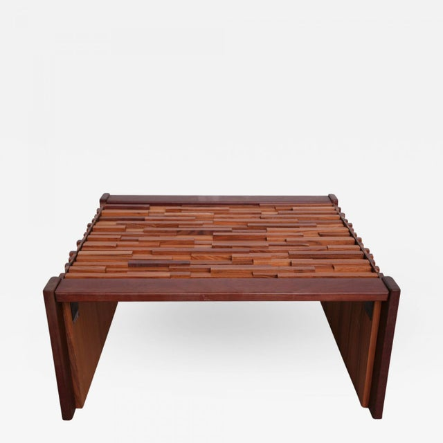 The whole done in strips of various lengths and types of wood, with glass top. (Priced individually).