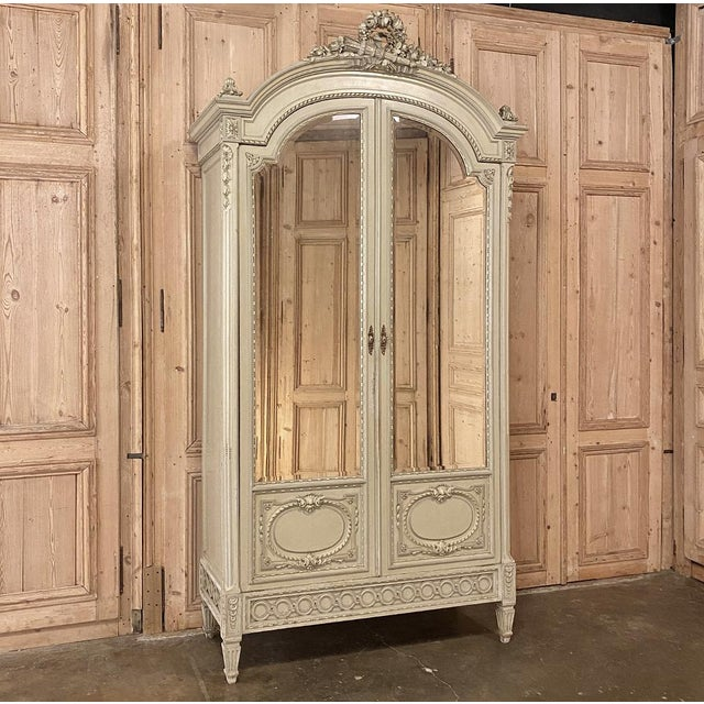 19th Century French Louis XVI Painted Armoire represents the epitome of Parisienne elegance! Hand-crafted by expert...