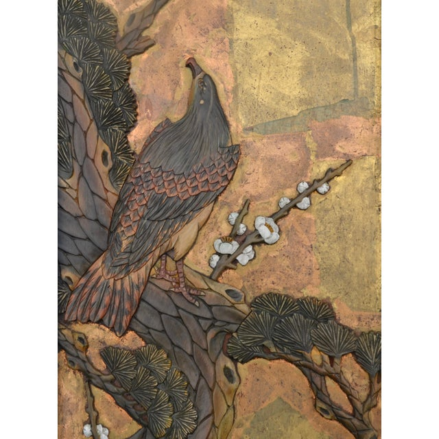 A Chinoiserie pair of beautiful carved and painted Chinese panels in the vertical and carved with birds and foliage on...