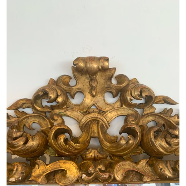 Purchased in Italy, Gold Gilt-wood wall mirror.