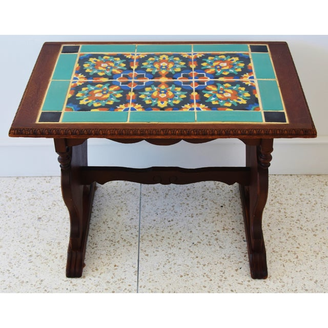 Circa 1940s California mission ceramic tile and oak wood side table. No maker's mark. Normal wear consistent with age and...