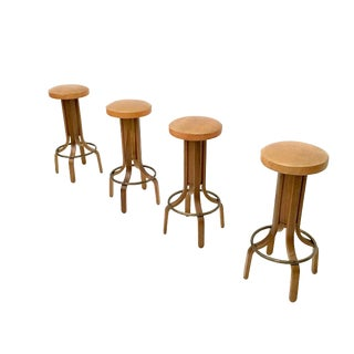 Set of Four Round Camel Color Leather and Walnut Plywood Revolving Stools, Italy, 1970s