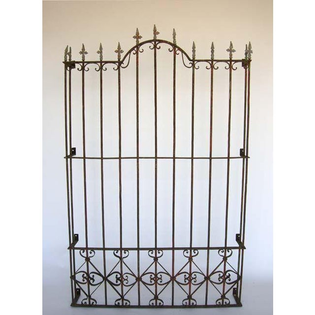 19th c. iron window grill with traces of paint. Beautiful old patina. Graceful lines. Can be sold separately or as a pair.